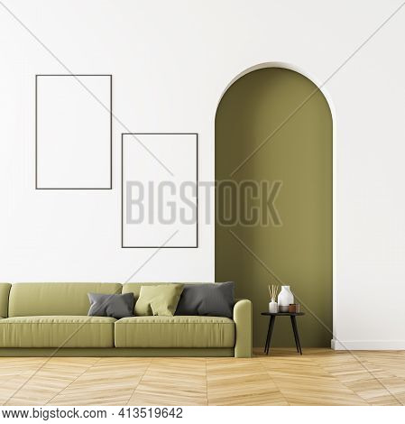 Living Room Interior With A Green Sofa On Oak Wooden Parquet, Cosy Coffee Table And Two Posters Near