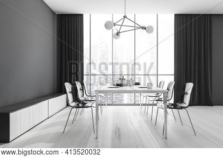 Wooden Eating Room Interior With Dishes On The Table And Black Chairs, Light Parquet. Modern Wooden