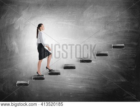 Woman Manager In Business Suit Climb Up The Stairs, Background Of Blackboard With Formula. Concept O