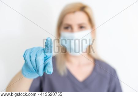Healthcare, Medicine And Technology Concept - Smiling Female Doctor Without Stethoscope Pointing To