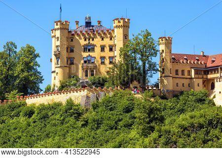 Hohenschwangau Castle In Germany. Schloss Hohenschwangau Is Famous Landmark Of Bavarian Alps. Scenic