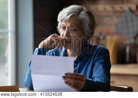 Stressed Older Latin Woman Get Bad Surprise Reading Official Letter