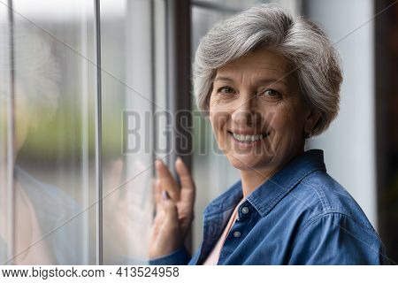 Headshot Portrait Of Attractive Senior Woman Enjoy Life In Retirement
