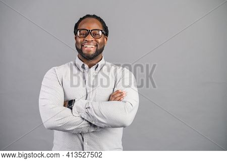 Concept Of Confident And Stylish Person. Full Length Of Cheerful Young African Man Keeping Arms Cros