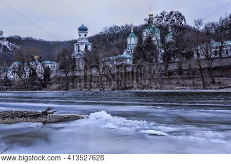 Church Of The Sviatohirsk Lavra In February. View From The Shore Of The Icy Siversky Donets