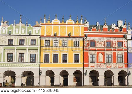 Zamosc, Poland, December 27, 2020. View Of Colorful Buildings In The Historic Great Market Square At
