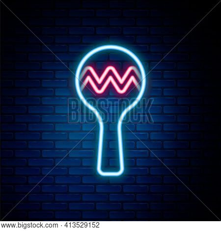 Glowing Neon Line Maracas Icon Isolated On Brick Wall Background. Music Maracas Instrument Mexico. C