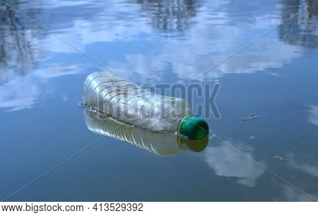 plastic bottle floating in river at the lake or river, water polluting issues.