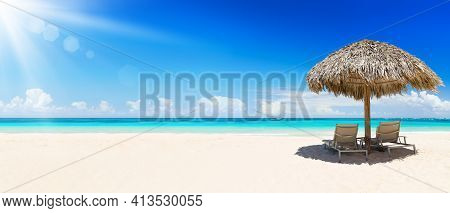 Beach Chairs With Umbrella And Beautiful Sand Beach In Punta Cana, Dominican Republic. Panorama Of T