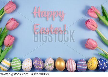 Pink Tulips Flowers And Colourful Eggs On Pink Background. Card For Happy Easter. Waiting For Spring