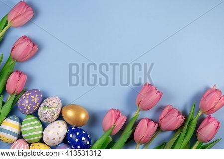 Pink Tulips Flowers And Colourful Eggs On Pink Background. Card For Happy Easter.