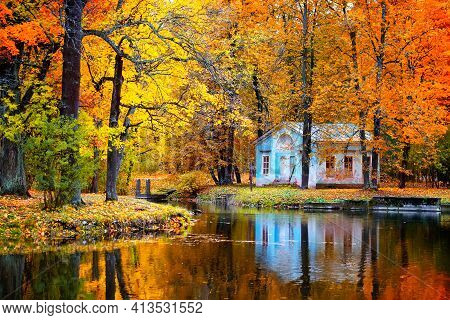 Autumn Landscape, Beautiful City Park With Fallen Yellow Leaves. Autumn Scenery With Footpath In Col
