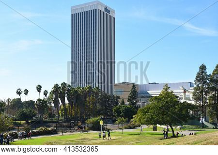 LOS ANGELES - NOVEMBER 24, 2017: Grounds at the La Brea Tar Pits with city skyline and LA County Museum of Art (LACMA) in the background.