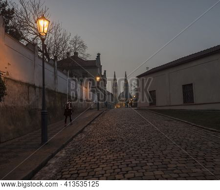 Czech Republic, Prague, February 23, 2021: Night View Of Cobbled Street At Vysehrad With Lanterns An