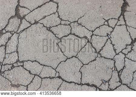 Cracked Asphalt Background. Old Pavement Texture With Cracks.