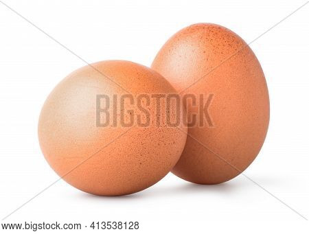 Two Brown Eggs Isolated On A White Background