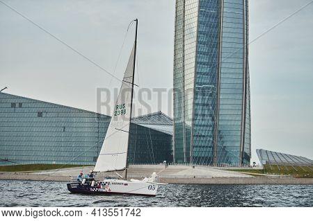 Russia, St.petersburg, 05 September 2020: Sailing Sport Boat Against The Highest Skyscraper In Europ