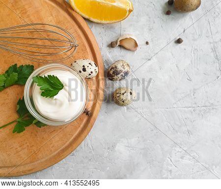 Homemade Mayonnaise, Quail Eggs On A Concrete Background