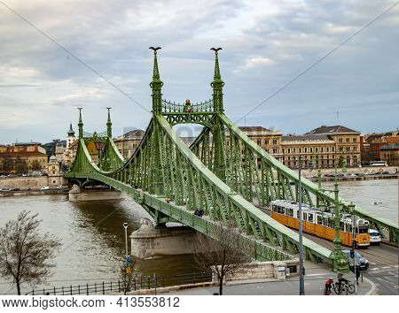 Budapest, Hungary, March 19, 2019: Liberty Bridge On The Danube River In Budapest, Hungary, And A Tr