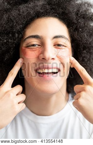 Man Skincare. Cosmetic Product. Fun Male Grooming. Happy Handsome Guy With Toothy Smile Brown Curly
