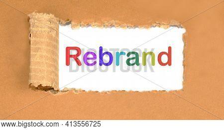 Rebrand Lettering On Torn Cardboard. Marketing Concept.