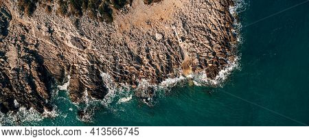 Dramatic Marine Background. Rocky Coast Of The Adriatic Sea. White Foamy Waves Beat Against The Ston