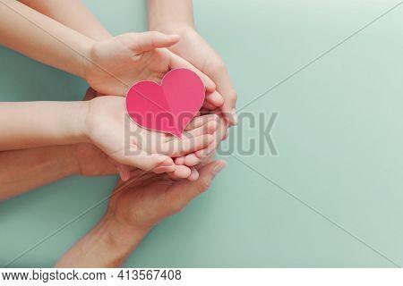 Family Hands Holding Red Heart, Heart Health Life Insurance, Organ Donation, Volunteer Charity, Csr