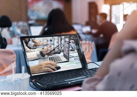 Asian Teacher Groups Computer Training Technology Or Coding Application In Smartphone With Laptop Fo