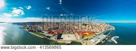 Aerial Panoramic View Of Lisbon City Old Town At Sunny Day. Commerce Square Or Praca Do Comercio In