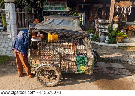 Santa Juliana, Philippines - Jan 30, 2018: Trycicle Carrying Eggs In Santa Juliana Village, Luzon Is