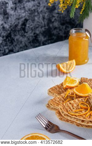 Folded Baked French Crepes Or Russians Blinis With Orange Slices And Jam And Copy Space. Spring Brea