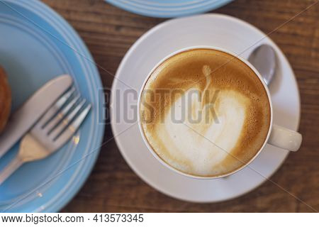 Top View Close Up Hot Cappuccino, Latte On Table With Blur Coffee Shop Background. Hot Cappuccino Co