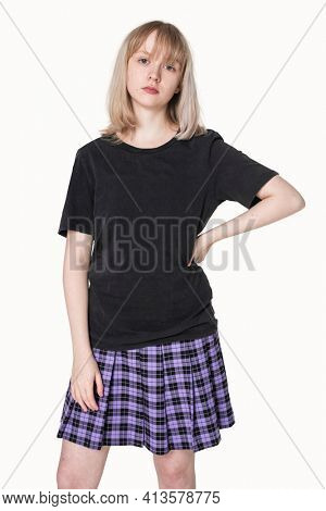 Blonde girl in black t-shirt and purple pleated skirt grunge fashion