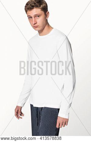 Teenage boy in white sweater winter apparel portrait