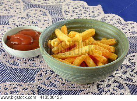 Ketchup Potato Sticks In Snack Bowl With Small Dipping Bowl Of Ketchup On Lace
