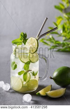 Infused Detox Water With Lime And Mint. Ice Cold Summer Cocktail Or Homemade Lemonade Healthy Drink