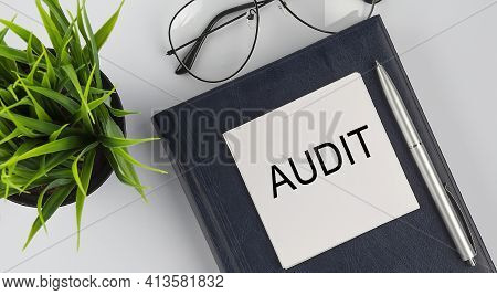 Stickers On Notebook Text Audit With Pen And Glasses On The White Background