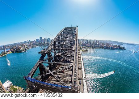Sydney Harbor Bridge is the largest bridge in Sydney, one of the largest steel arch bridges in the world. Boat trip on a tourist boat along the picturesque shores of the port