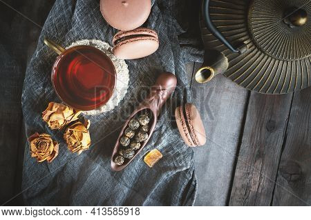 Fermented Chinese Tea In A Ceramic Scoop With Almond Cookies On The Background Of A Wooden Table Wit