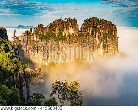The Schrammsteine Rock Formations Stand In An Area Known As Saxon Switzerland Park Near Bad Schandau