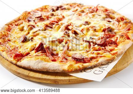 Italian Pizza - Traditional Pepperoni Pizza on Wooden Dish made with Sausage Slice, Tomato Sauce and Cheese. Isolated on White Background