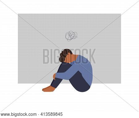 A Lonely Black Skin Man Sitting And Hugging His Knees Above Scribbles. Young Depressed Male Characte