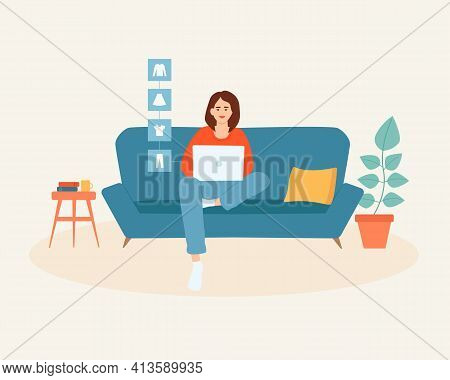 Young Woman With Laptop Sitting On The Couch Doing Online Shopping, Buying Clothes. Online Shopping
