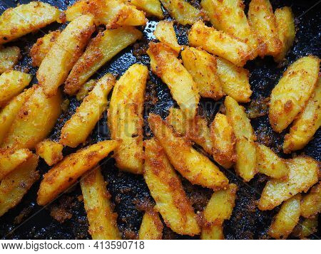 Fried Potatoes Or French Fries With Turmeric, Curry And Bread Crumbs. Close-up. Delicious Side Dish.