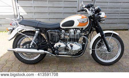 Bordeaux , Aquitaine France - 03 18 2021 : Triumph Bonneville T100 Motorcycle Side View With Sign Te