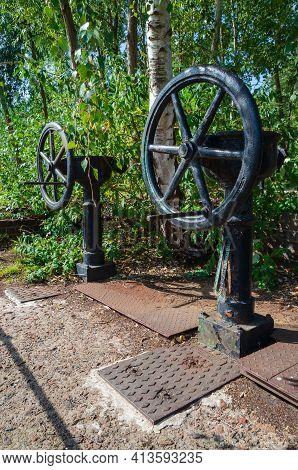 Flint, Flintshire; Uk: Sept 17, 2020: Old Manually Operated Sluice Gate Valves At Flint Dock Remain,
