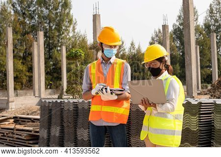 A Team Of Male And Female Engineers Or Architects Is Exploring And Inspecting The Outdoor Constructi