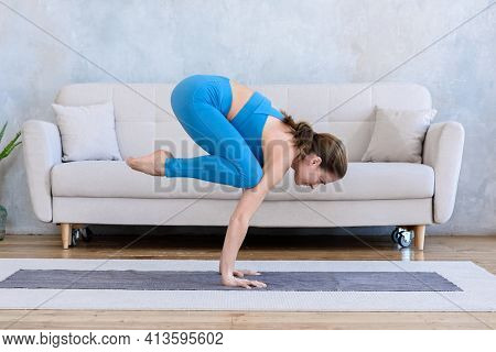 Sportive Woman Practicing Yoga At Home On Mat Doing Pigeon Pose