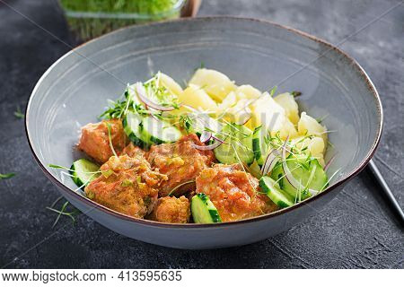 Steamed Fish Fillet With Tomatoes Sauce, Boiled Potatoes And Fresh Cucumber Salad. Diet Meal. Lenten