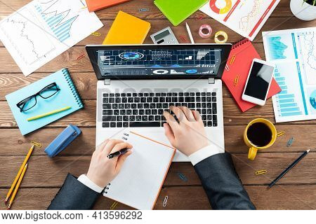 Close Up Businessman Hands Working At Laptop. Top View Office Workplace With Computer And Financial